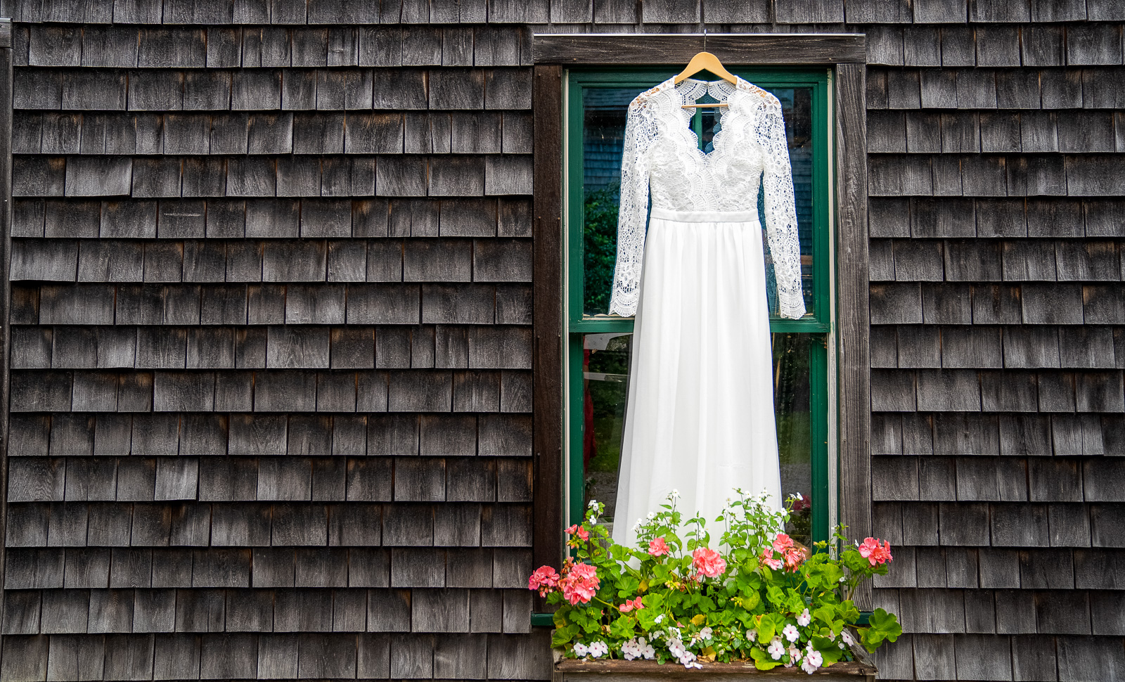 Wedding gown hanging on barn