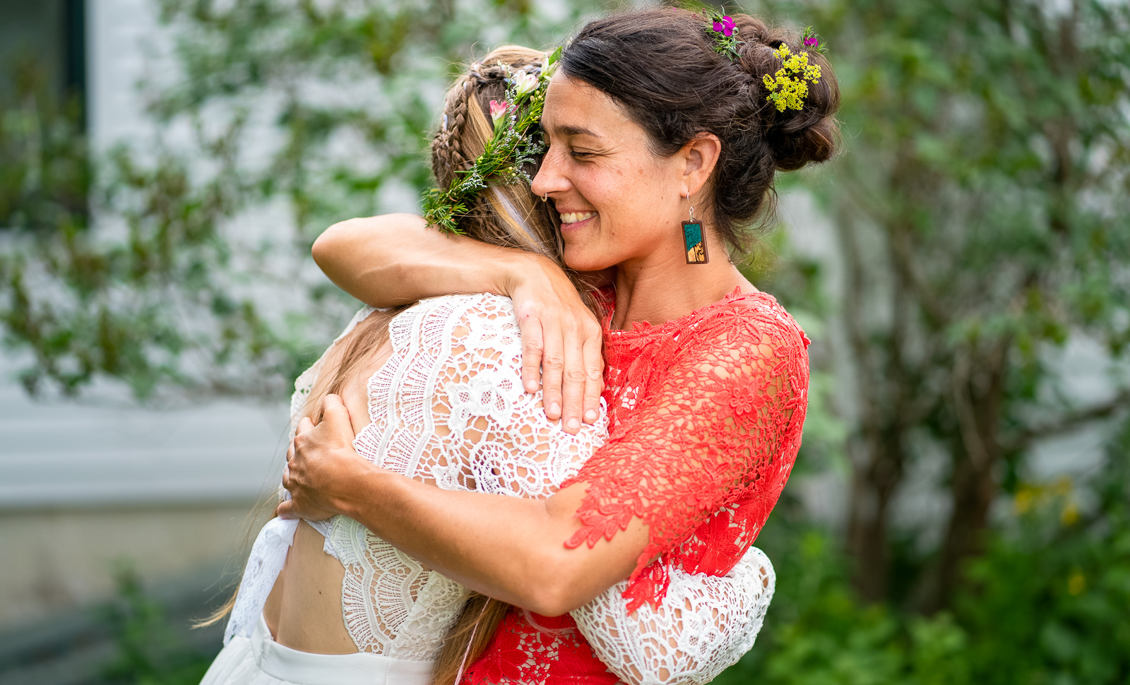 Bride hugging friend