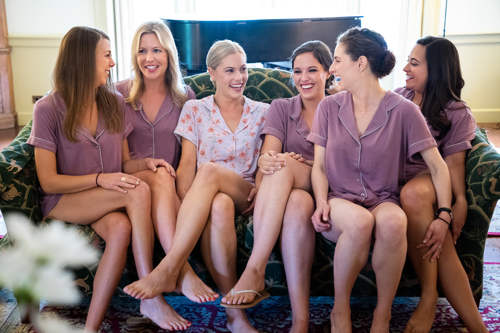 Bridal party laughing on couch casual