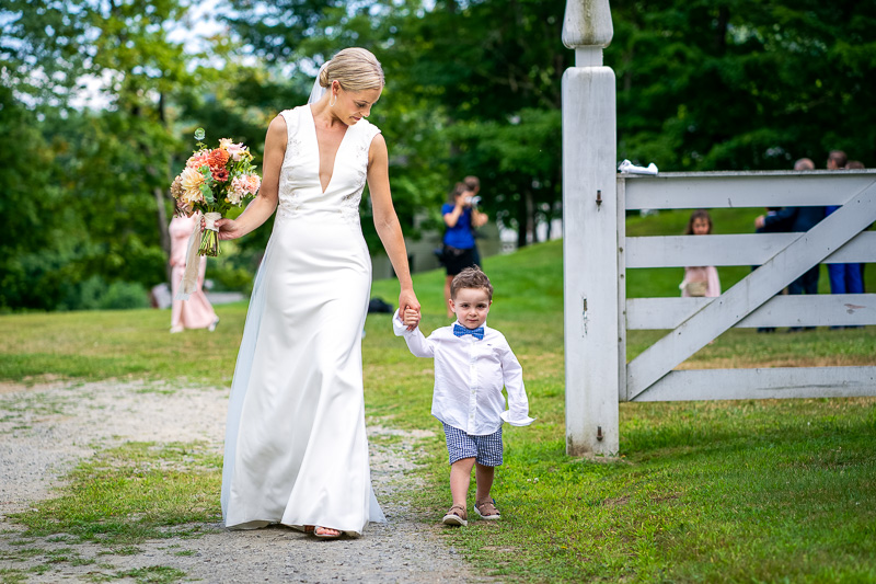 Bride walking with ring bearer