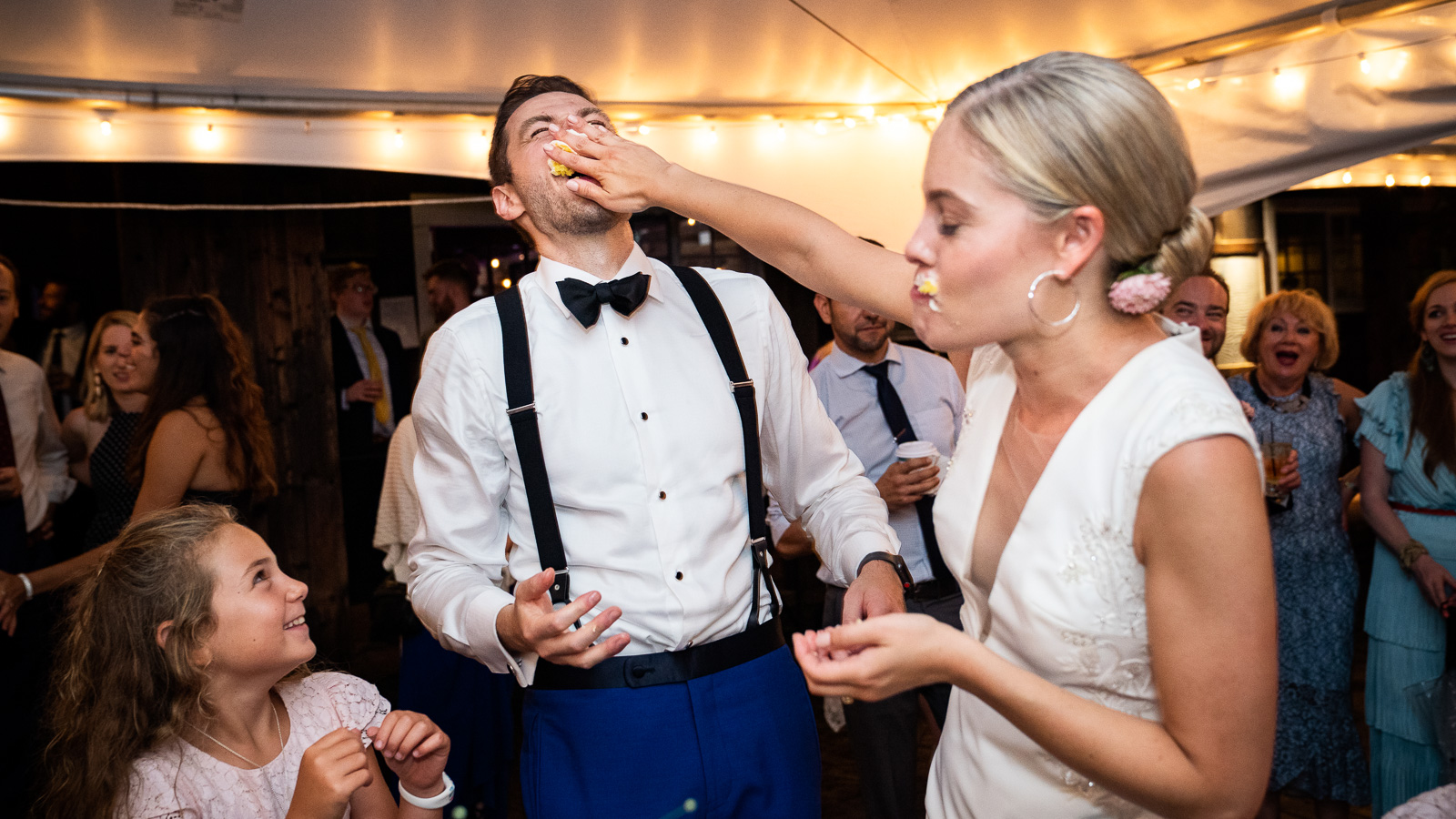 Bride smashing cake in Grooms Face