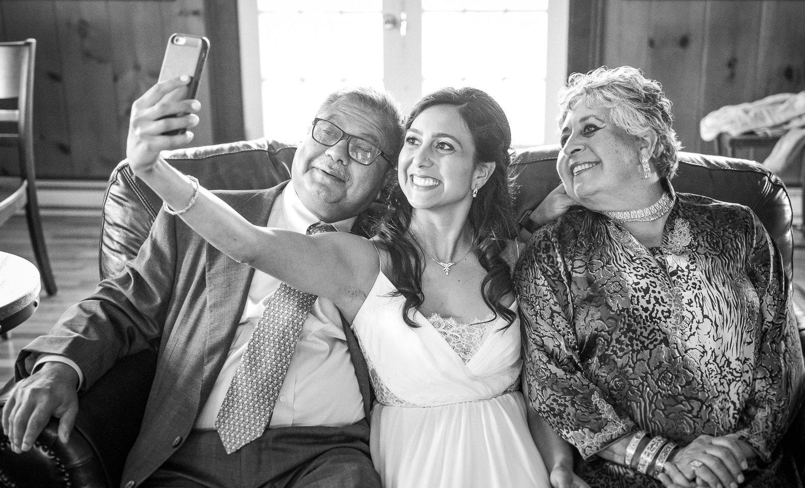 Bride selfie with parents